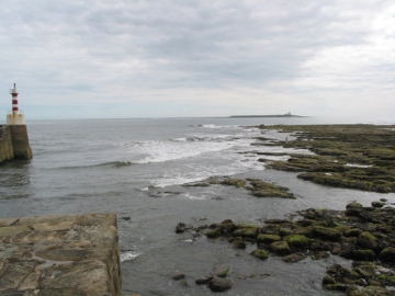 View_from_the_entrance_to_Amble_harbour_towards_Coquet_Island_-_geograph.org.uk_-_414802