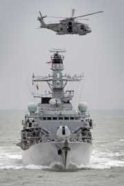 Royal Navy Frigate HMS Sutherland with a Merlin Helicopter Overhead (WikiCommons)